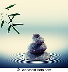 Wet pebble in the water with bamboo foliage on backgrounds, alte
