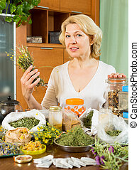 mature woman  with herbs