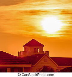 buildings silhouettes at sunrise on cape hatteras natinal...