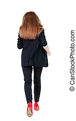 running business woman. back view. going young girl in suit....