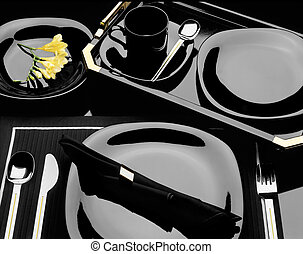 Black dinnerware - A elegant image of a place setting of...