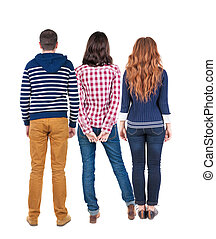 Back view of three people. beautiful friendly girl and guy...
