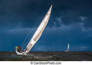 Sailing in heavy weather - Sailing yacht in a stormy...
