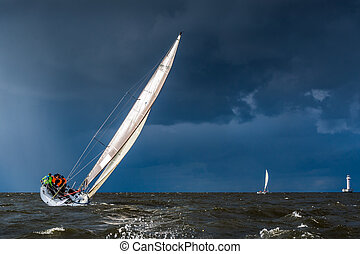Sailing in a gale - Sailing yacht going before storm Heavy...
