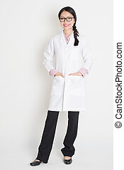 Asian Chinese girl in white lab uniform - Portrait of Asian...