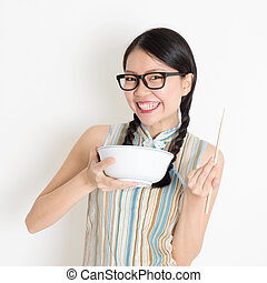 Asian Chinese girl eating - Portrait of Asian Chinese girl...