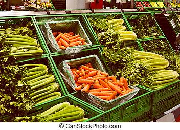 Supermarket - Vegetables at a supermarket, including carrots...