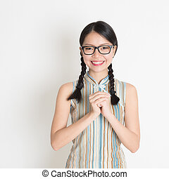 Asian Chinese girl greeting - Happy Chinese New Year!!...