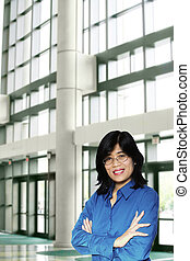 Confident asian business woman standing arm crossed