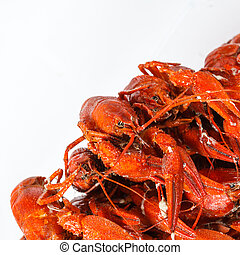 Boiled crayfish on a white background, a traditional Russian...