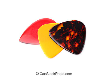 Colourful guitar plectrums on white background