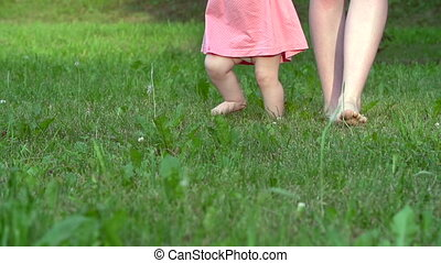 First Achievements - Low angle of woman walking with child...