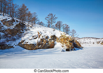 Baikal in winter - Rock in frozen siberian Baikal Lake in...