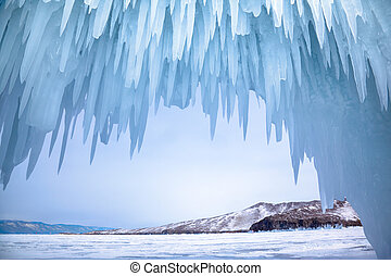 Ice cave near siberian lake Baikal in winter