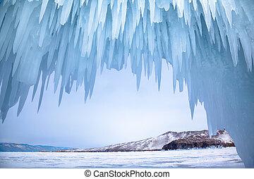 Ice cave near siberian lake Baikal in winter