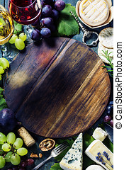 Wine, grape and cheese - Food background with Wine and...