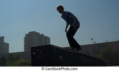 Skateboard Dive - Slow motion of skateboarder leaping down...