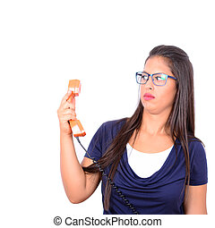 Portrait of young female in shock while talking on phone...