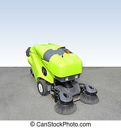 Street sweeper - Front view of green street sweeper cleaner...