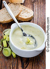 Fresh made Leek Soup in a bowl on wooden background