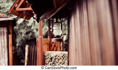 vintage farm lamp - farm building vintage lamp at rainy day