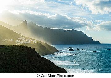 Mountain village at sunset last golden light. Benijo,...
