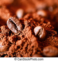 Closeup of two coffee beans at roasted coffee heap macro...