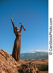 Music for eternity - Girl in concert dress with violin...