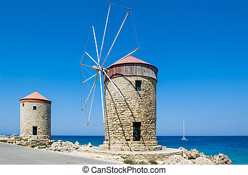 Windmill at Rhodes - Old windmill at Rhodes island marina...