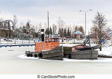 Frozen vessels in the river. Helsinki, Finland - Winter shot...
