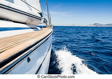 Sail adventure - Sailing boat in fast motion view from board