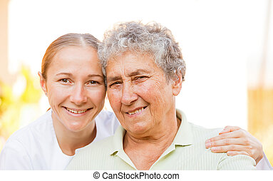 Elderly home care - Closeup photo of elderly woman with the...