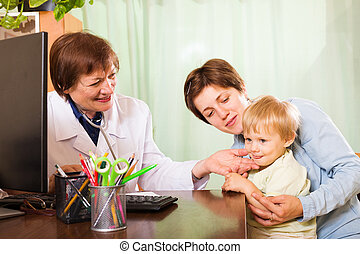 pediatrician doctor examing baby at clinic office