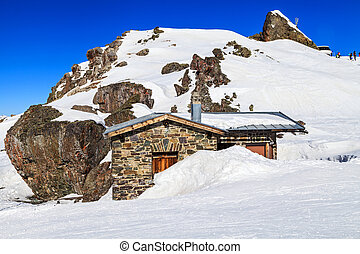 Mountain hut - Picture of snowy winter landscape in the Alps