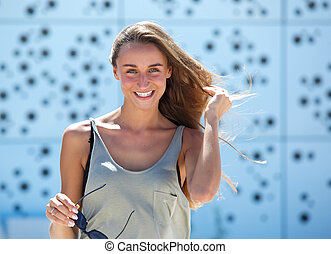 Young woman smiling outdoors - Portrait of a young woman...