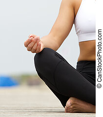 Young woman hands in yoga pose outdoors - Close up portrait...