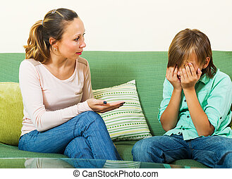 Mother berating teenager son - Ordinary mother scolding...