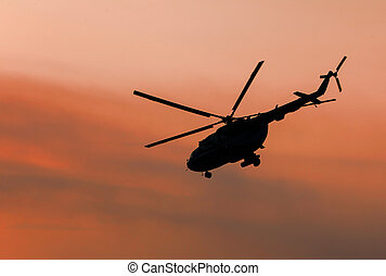 Ukrainian military helicopter in flight against a dramatic...