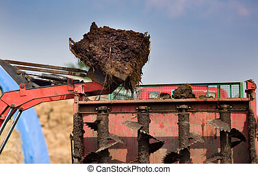 Bucket with natural manure loading trailer for field...