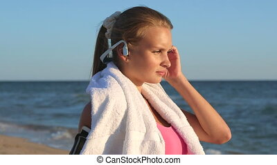 Face of fitness girl relax listening to music after workout...