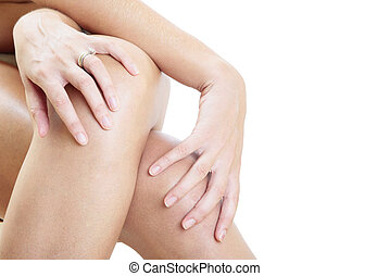 Hands and Legs - Woman massaging her legs over a white...