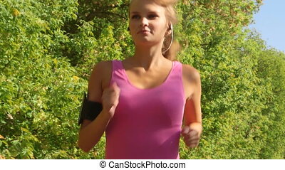 Fit sports woman running at park during outdoor workout