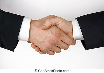 Business handshake Image of businesspeople handshake on the...