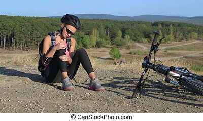 Workout fitness injuries woman cyclist with pain in knee...
