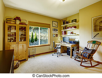 Cozy office room with rocking chair