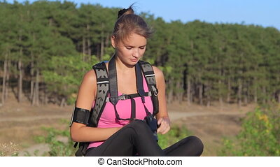 Hiking young woman taking pictures during hike trekking in...