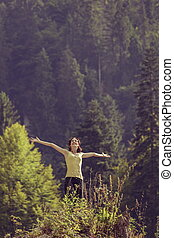 Freedom, triumph - Young delighted woman with arms wide...