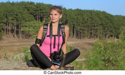 Hiking young woman looking away during hike trekking in forest