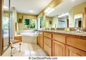 Bright bathroom with corner bath tub