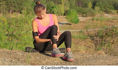 Workout fitness injuries young woman with pain in the leg...